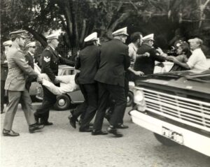 Queensland Politics - Police Brutality (pic of protestor carried by police).